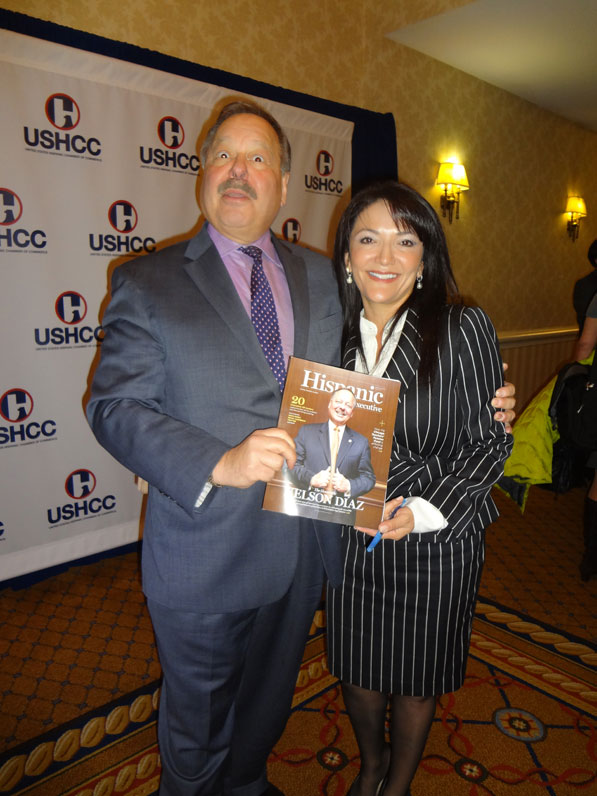 Nina Vaca, Chairman and CEO of PInnacle Technical Resources, poses with HE cover star Nelson Diaz.