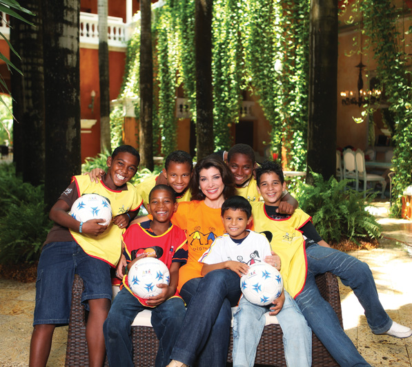 Janiot with members of the Colombianitos Goals For a Better Life soccer program in Cartagena, Colombia. Ninety-eight percent of the children in this program are enrolled in and attending school. Colombianitos benefits more than 4,300 children.