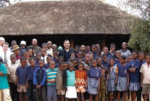 Vasquez visits an orphanage in South Africa while traveling as director of the Peace Corps.