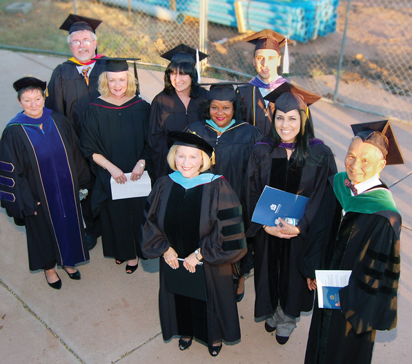Dr. Anna Solley (front, center), Phoenix College president, with other Phoenix College administrators, faculty, staff, and keynote speaker Dr. Simon Myint (far right), prepare to celebrate the annual commencement ceremony.