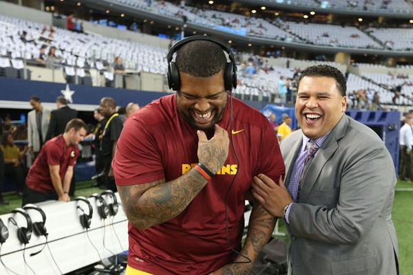 Offensive tackle Trent Williams (left) and Director of Pro Personnel Alex Santos (right) at the Dallas Cowboys' AT&T Stadium.