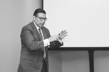 DDR Advisors LLC president Dr. Robert Rodriguez moderates the panel. Photo by Sheila Barabad.