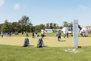 Pro golfers, including Championship winner Jason Day, practice on the BMW Experience Center putting green
