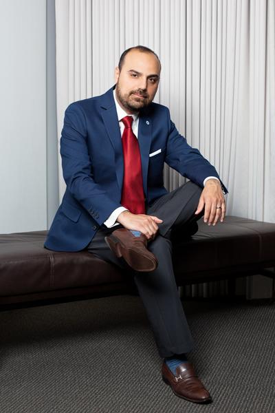 Edgar Mayorga, Johnson Controls, seated leg crossed