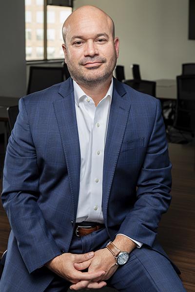 Ricardo Madan, TEKsystems, portrait office background