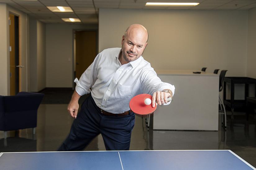 Ricardo Madan, TEKsystems, playing ping-pong