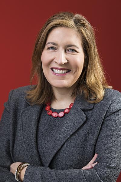 Beatriz Perez, SVP, The Coca-Cola Company, portrait red background