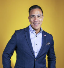 Guillermo Diaz, SVP of Customer Transformation, Cisco Systems, portrait yellow background