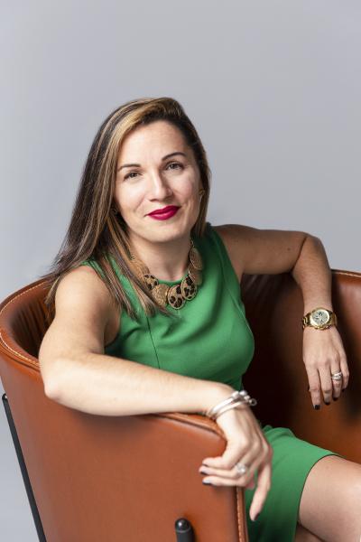 Jennifer Rodriguez, FCB Global, portrait sitting in brown chair