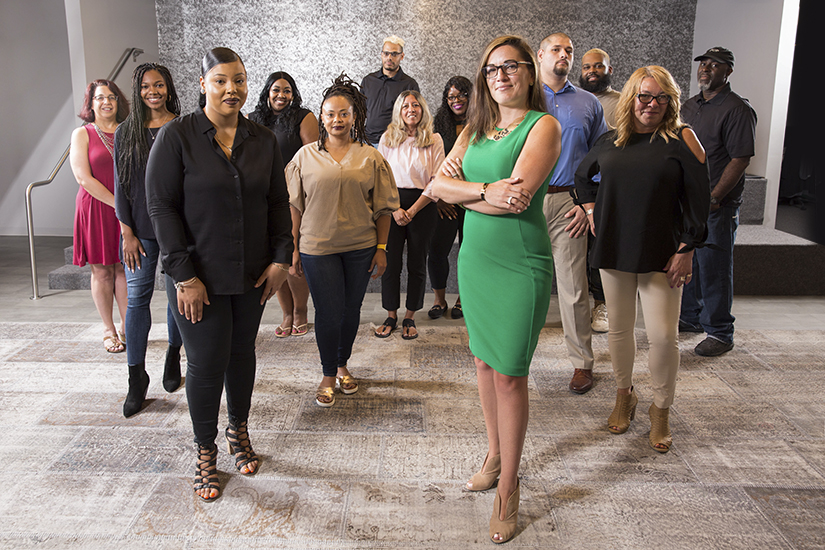 Jennifer Rodriguez, FCB Global, center of group shot standing arms crossed