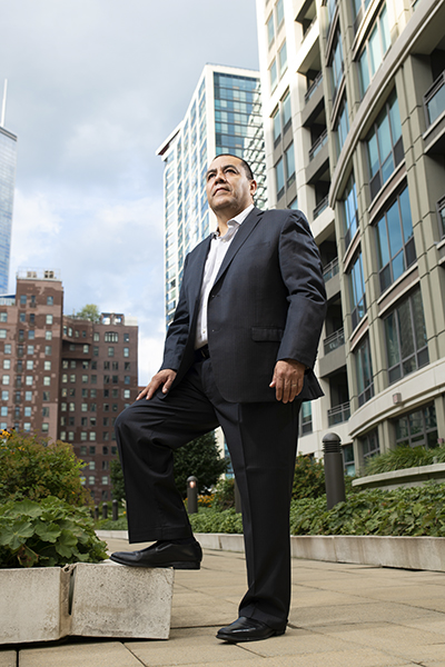 Martin Escutia, VP of Services for Mexical, Central American & Caribbean, Infinera, portrait outdoors standing looking up