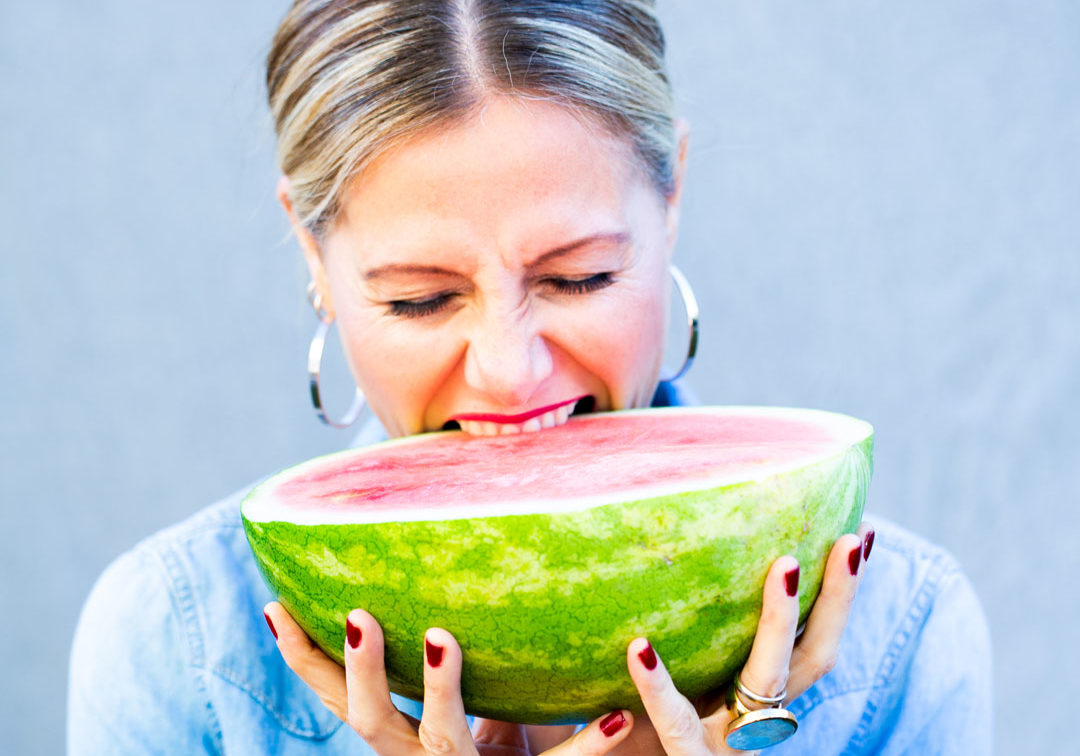 Alejandra Graf, biting into watermelon, thumb