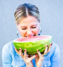 Alejandra Graf, biting into watermelon, thumb