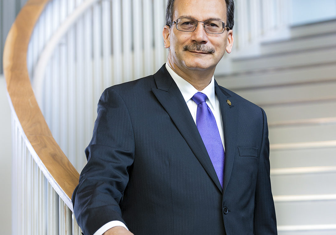 Havidán Rodríguez, President, University at Albany - portrait on stairs