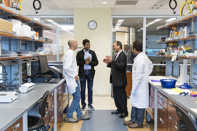 President-Elect Havidán Rodríguez is introduced by Prash Rangan to Bijan Dey and Ken Halvorsen of the RNA Institute