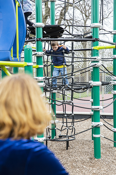 Talita Ramos Erickson watching her son play at a playground Northbrook on April 26, 2019