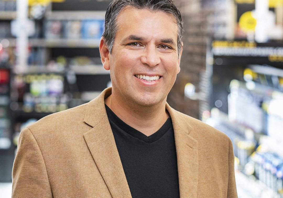 Adolfo Rodriguez, SVP of IT Transformation, Advance Auto Parts_portrait brown jacket thumbnail