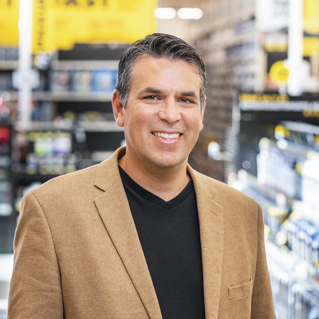 Adolfo Rodriguez, SVP of IT Transformation, Advance Auto Parts_portrait brown jacket thumbnail