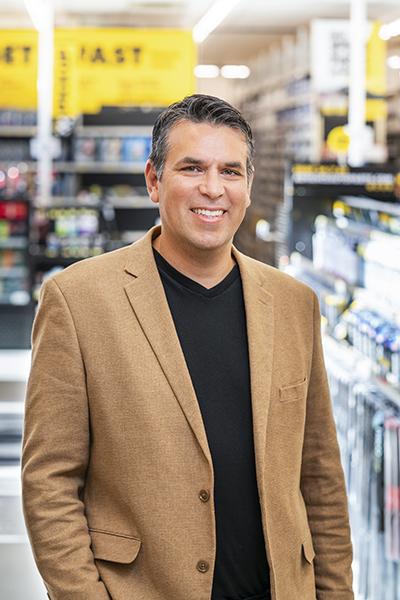 Adolfo Rodriguez, SVP of IT Transformation, Advance Auto Parts_portrait brown jacket