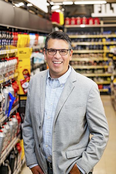 Adolfo Rodriguez, SVP of IT Transformation, Advance Auto Parts_portrait gray jacket