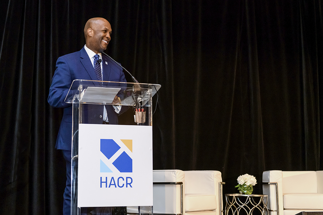 Cid Wilson, President and CEO of HACR, speaking at a podium