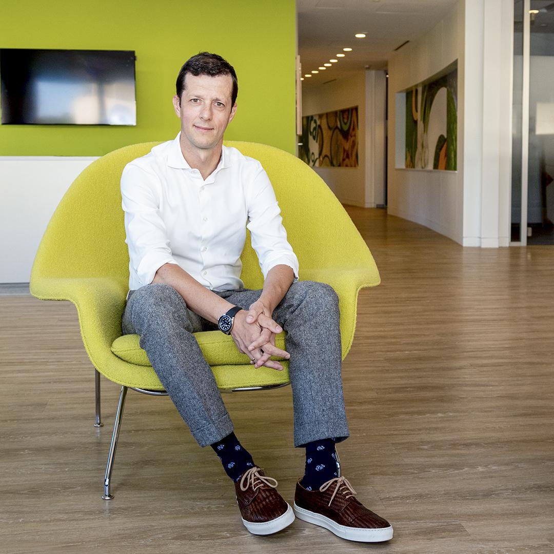 Sergio Ezama, PepsiCo, portrait sitting green chair thumbnail