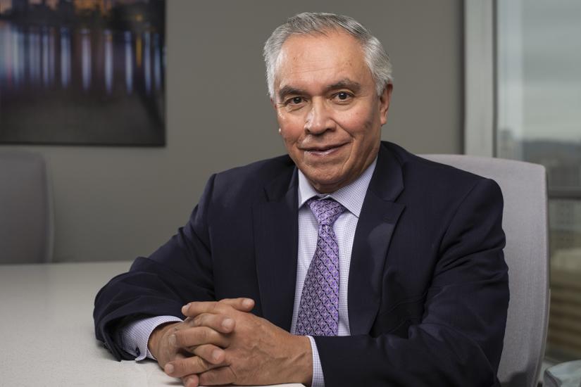 David Chavez, Senior Advisor, SVN | QAV & Associates portrait hands crossed