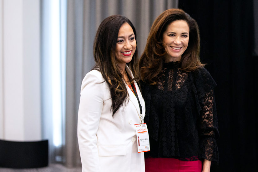 Claudia Romo Edelman poses with Patricia Mota at HACE event
