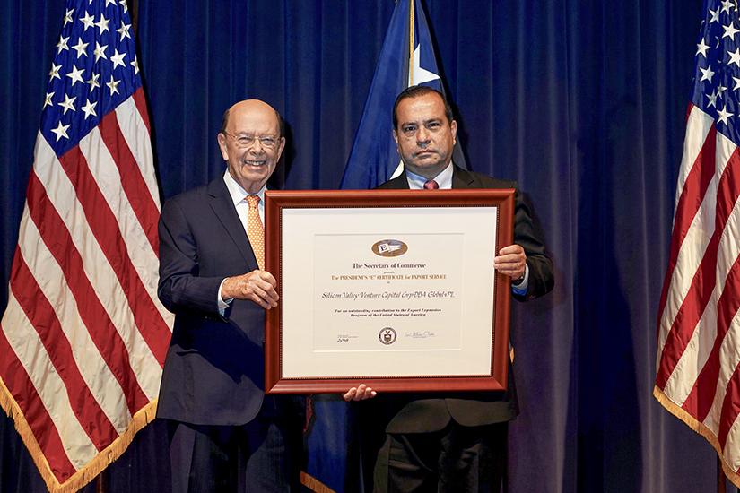 "Sergio Retamal accepts President's ""E"" Award from Secretary of Commerce Wilbur Ross"
