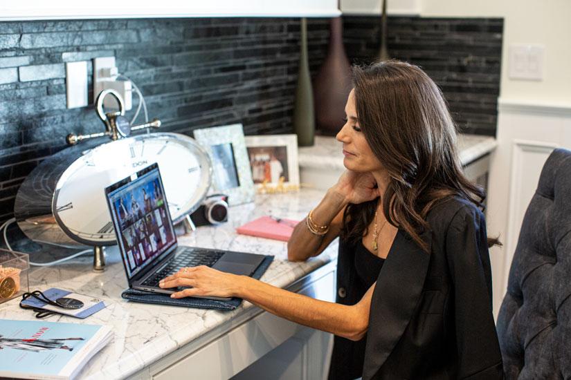 Andrea Trujillo at desk