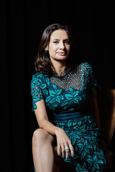 María Teresa Kumar, founding president and CEO, Voto Latino, portrait sitting leaning forward